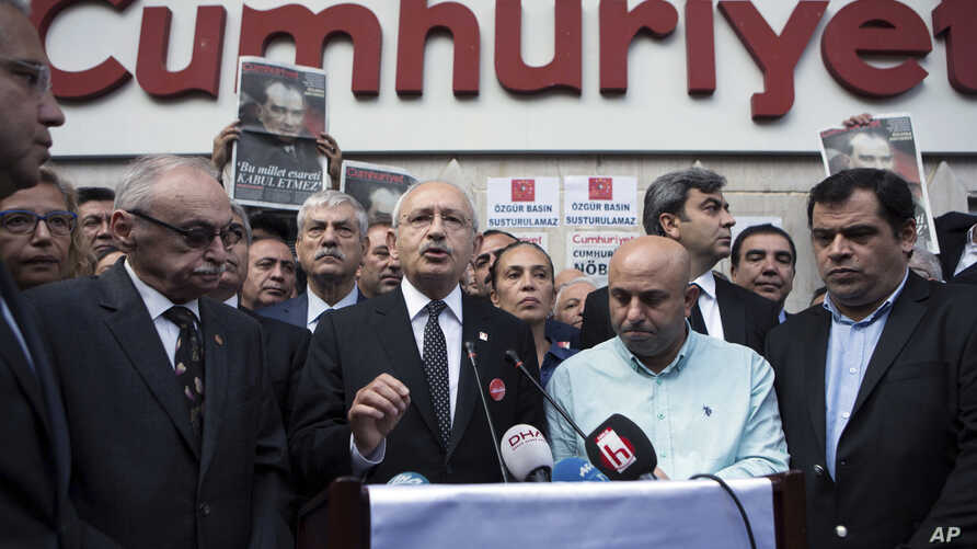 Turkey's main opposition Republican People's Party leader Kemal Kilicdaroglu speaks to the media after his visit in solidarity to Cumhuriyet newspaper in Istanbul, Thursday, Nov. 10, 2016.