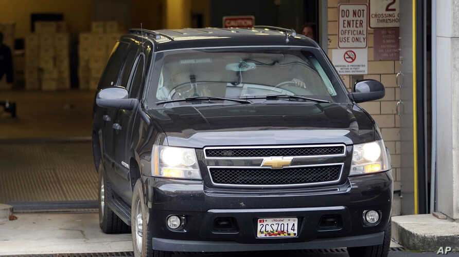 A vehicle believed to be carrying Mustafa al-Imam leaves U.S. District Court in Washington, Nov. 3, 2017. Al-Imam is accused of playing an instrumental role in the Benghazi attacks and was ordered to remain behind bars. He faces three charges that w