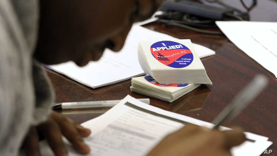 A student at Roosevelt High School in Washington, DC fills out a college enrollment application. President Barack Obama's goal is that by 2020, America will again have the highest proportion of college graduates in the world.