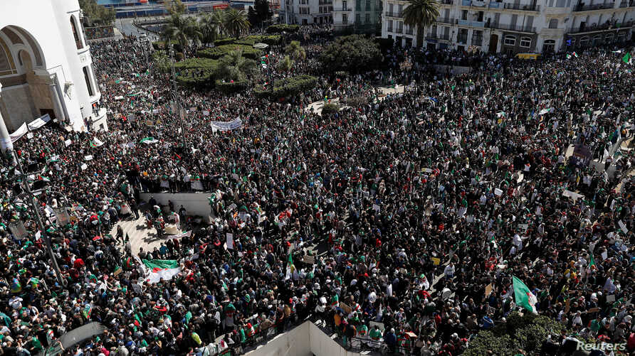 People gather during a protest over President Abdelaziz Bouteflika's decision to postpone elections and extend his fourth term in office, in Algiers, Algeria, March 15, 2019.