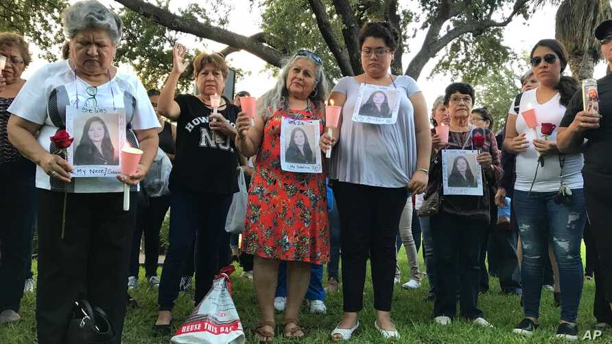 Dozens of family members and friends of four women who authorities say were killed by a U.S. Border Patrol agent gather for a candlelight vigil at a park in downtown Laredo, Texas, on Sept. 18, 2018.