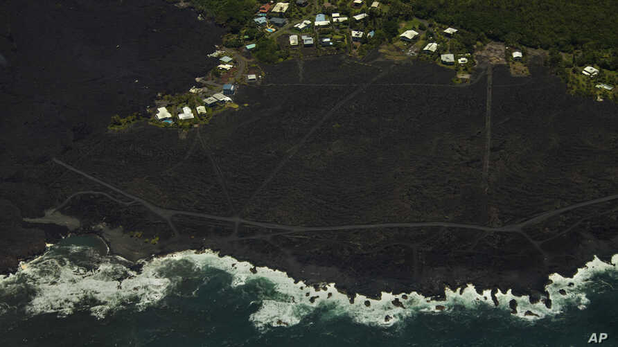 Most of the Kapoho area, including the tide pools, is now covered in fresh lava with few properties still intact as the Kilauea volcano lower east rift zone eruption continues in Pahoa, Hawaii, June 6, 2018.