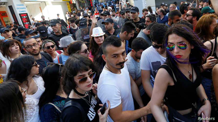 Riot police disperse LGBT rights activists as they try to gather for a pride parade, which was banned by the governorship, in central Istanbul, Turkey, June 25, 2017.