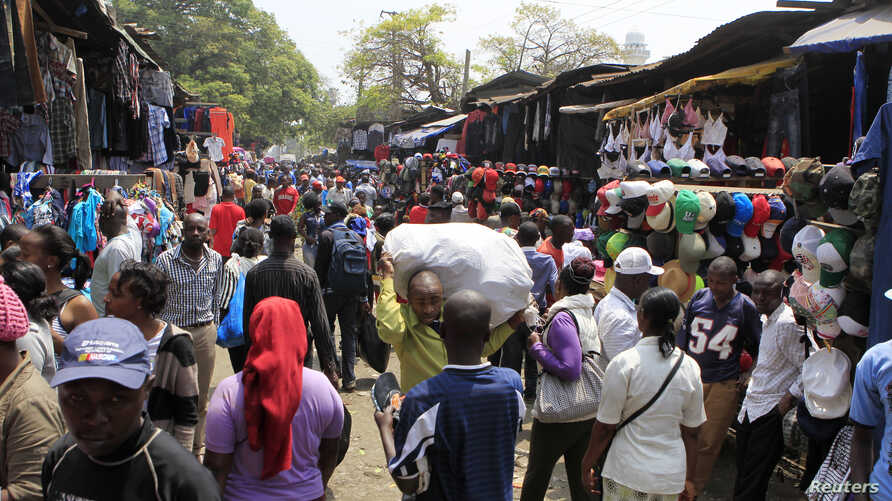 People go about their secondhand shopping at the busy the Gikomba market in Nairobi, Sept. 18, 2014.