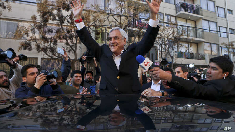 Sebastian Pinera, Chile's former president who is a candidate in the presidential primary election, waves after voting in his party's primary election in Santiago, Chile, July 2, 2017.