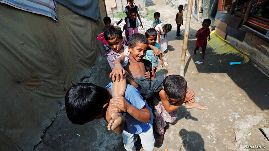 Children from the Rohingya community play outside their shacks in a camp in New Delhi, India October 4, 2018.
