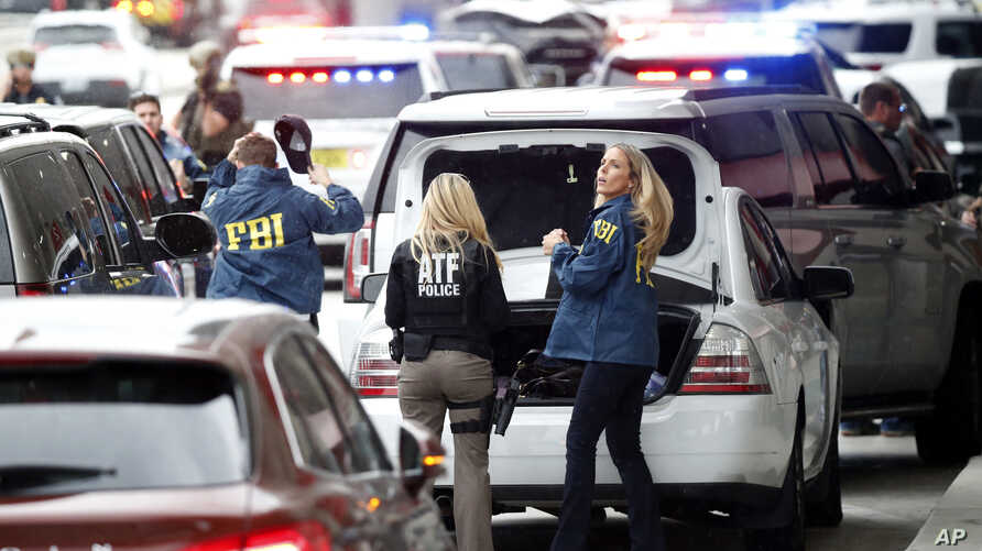 Members of the ATF and FBI arrive at Fort Lauderdale–Holly