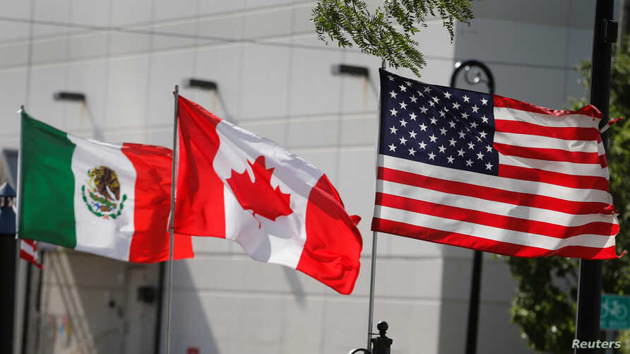 Flags of the U.S., Canada and Mexico fly next to each other in Detroit, Michigan, U.S. Aug. 29, 2018.