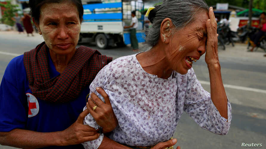 The grandmother of Tun Tun, a 36-year-old funeral bus driver killed in a recent riot, cries at a cemetery in Mandalay, Myanmar, July 3, 2014.