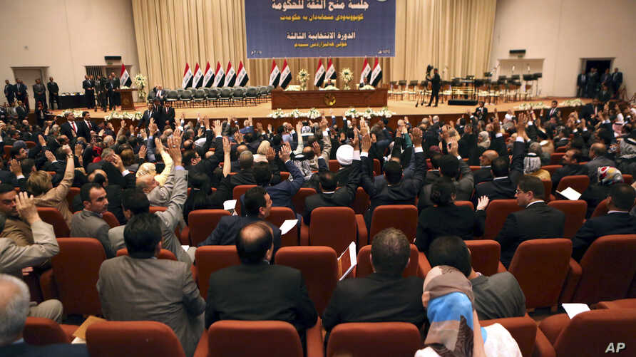 FILE - Iraqi lawmakers attend the session to approve the new government in Baghdad, Iraq, September 2014.