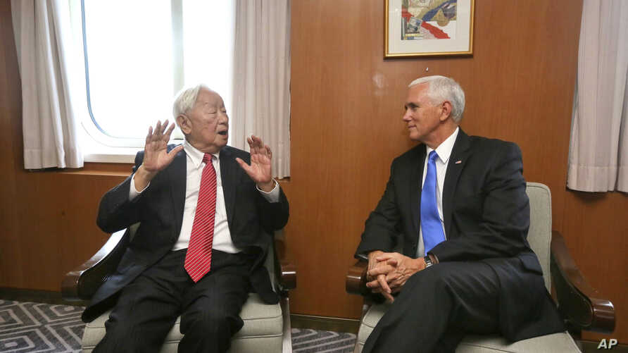 In this photo released by Taiwan's Ministry of Foreign Affairs, Taiwan's special APEC envoy Morris Chang, left, meets with U.S. Vice President Mike Pence on the Pacific Explorer cruise ship on the sidelines of the APEC Summit, Nov. 17, 2018, in Port