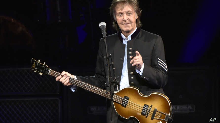 FILE - Paul McCartney performs on the One on One Tour at the Hollywood Casino Amphitheatre in Tinley Park, Ill., 26, 2017.