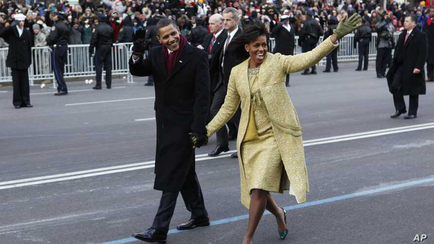 President Barack Obama and first lady Michelle Obama walk the inaugural parade route in Washington, Jan. 20, 2009.