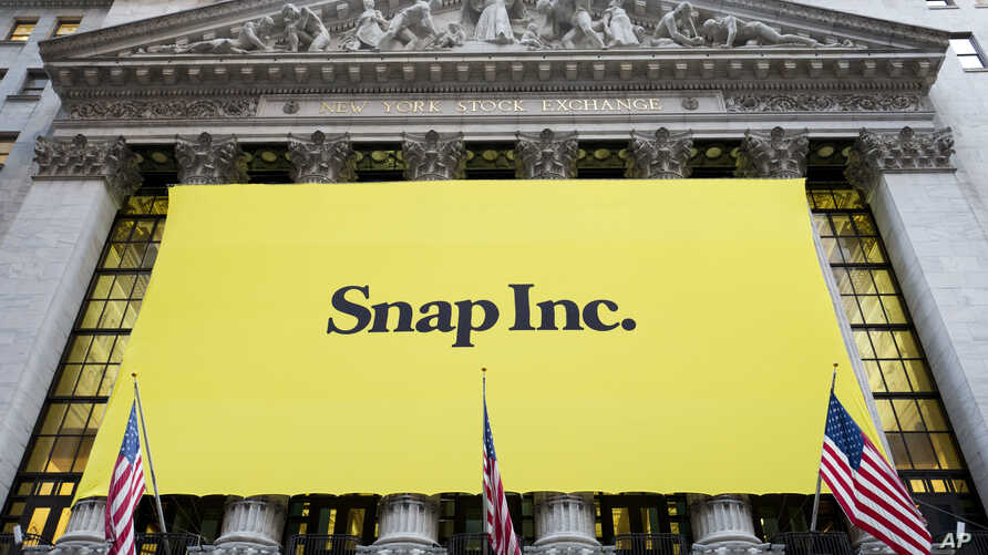 A banner for Snap Inc. hangs from the front of the New York Stock Exchange, March 2, 2017, in New York.