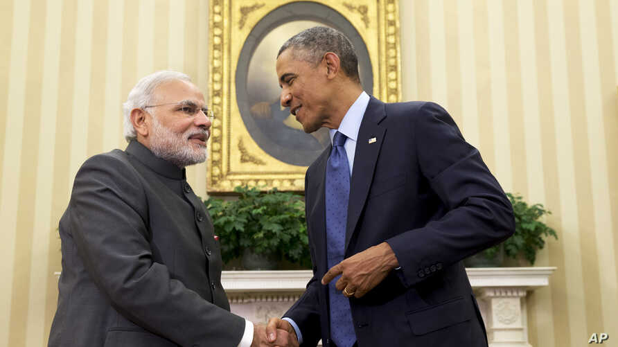 "President Barack Obama shakes hands with Indian Prime Minister Narendra Modi, Tuesday, Sept. 30, 2014, in the Oval Office  of the White House in Washington. President Barack Obama and India's new Prime Minister Narendra Modi said Tuesday that ""it is ..."