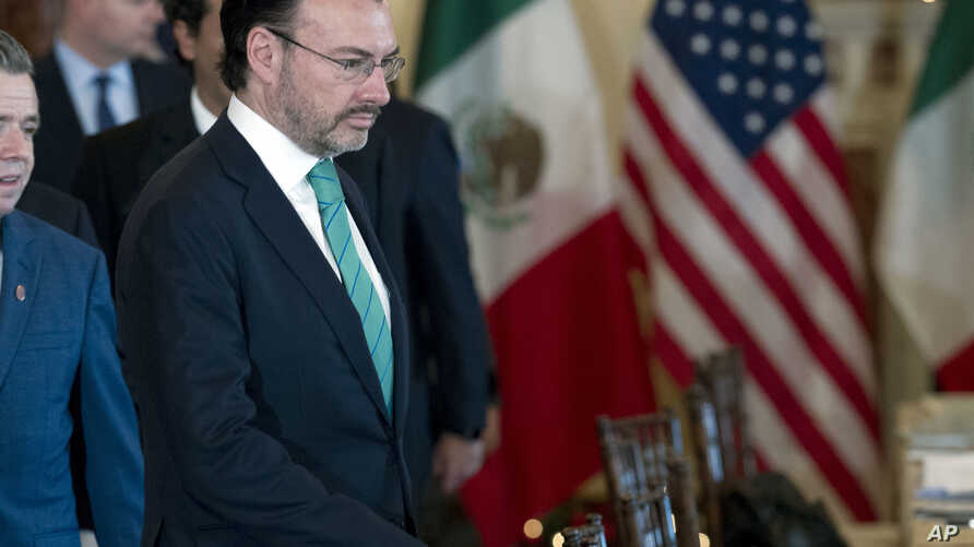 Mexico's Foreign Secretary Luis Videgaray walks to his chair during the US-Mexico bilateral meeting on disrupting transnational criminal organizations at State Department in Washington, Dec. 14, 2017.