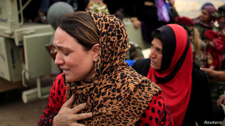A newly internally displaced woman reacts upon her arrival at Al Khazar camp near Hassan Sham, east of Mosul, Iraq Oct. 28, 2016.