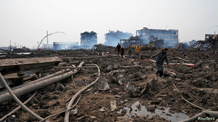 Relatives look for a missing worker at the pesticide plant owned by Tianjiayi Chemical following an explosion, in Xiangshui county, Yancheng, Jiangsu province, China, March 23, 2019.