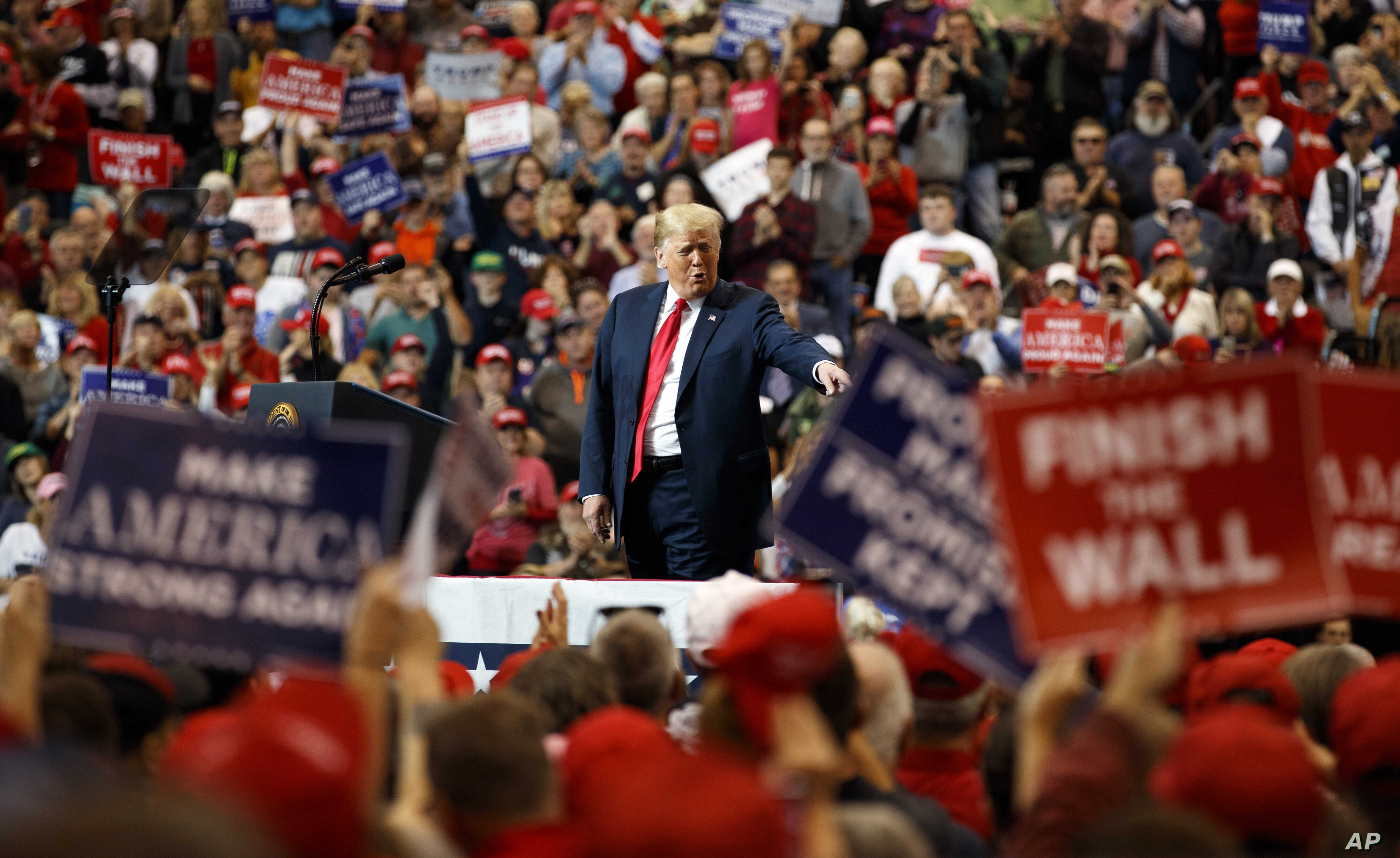 President Donald Trump arrives to speak at a campaign rally at the IX Center, in Cleveland, Nov. 5, 2018.