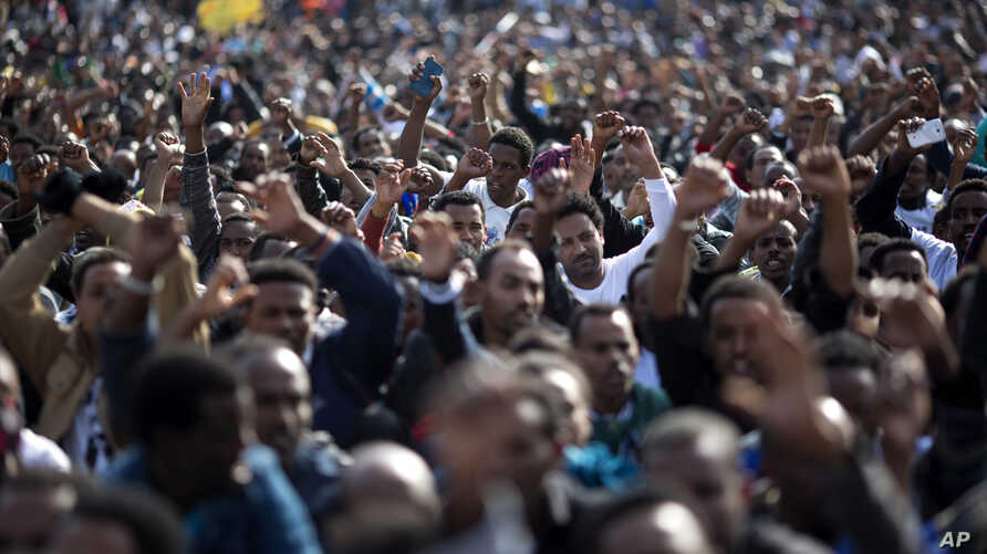 FILE - African migrants chant slogans during a protest in Rabin's square in Tel Aviv, Israel, Sunday, Jan. 5, 2014.