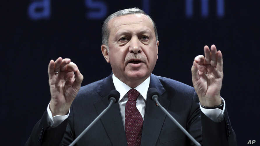 Turkey's President addresses police officers in Ankara, Turkey, Tuesday, Nov. 22, 2016. Turkey's government on Tuesday dismissed a further 15,000 people from the military, police and the civil service as part of an ongoing investigation into the fail
