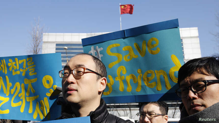 Activists attend a rally held to demand China not to send a group of North Korean defectors back to the North, near the Chinese embassy in Seoul, February 18, 2012.