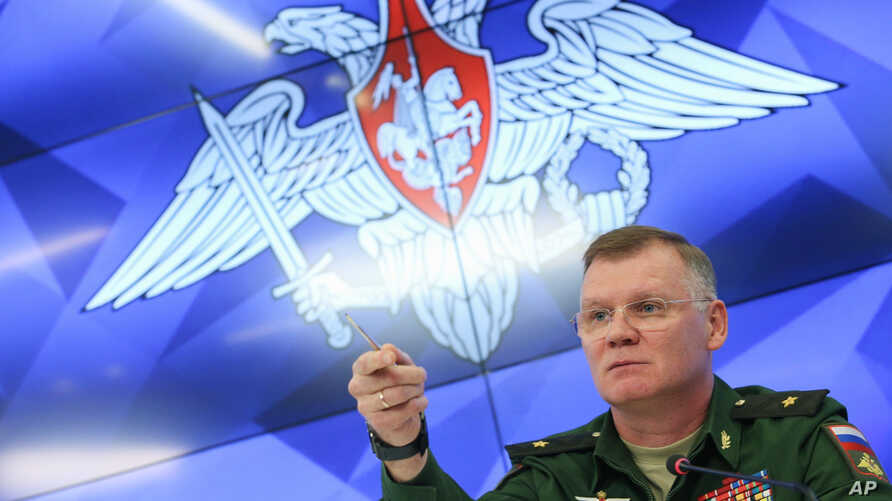 Defense Ministry spokesman Maj. Gen. Igor Konashenkov speaks to the media during a press conference, in Moscow, Russia, Sept. 17, 2018.