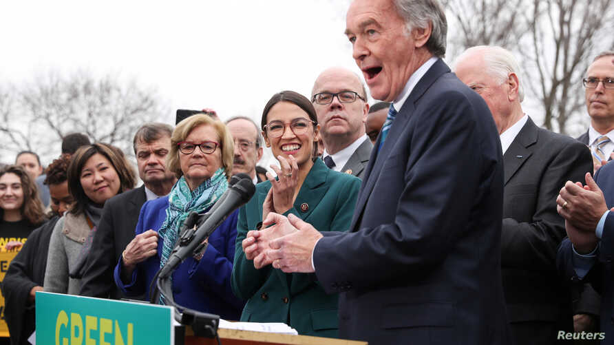 """FILE - Sen. Ed Markey, D-Mass., and Rep. Alexandria Ocasio-Cortez, D-N.Y.,  hold a news conference for their proposed """"Green New Deal"""" to achieve net-zero greenhouse gas emissions in 10 years, at the U.S. Capitol in Washington, Feb. 7, 2019.  The Rep"""