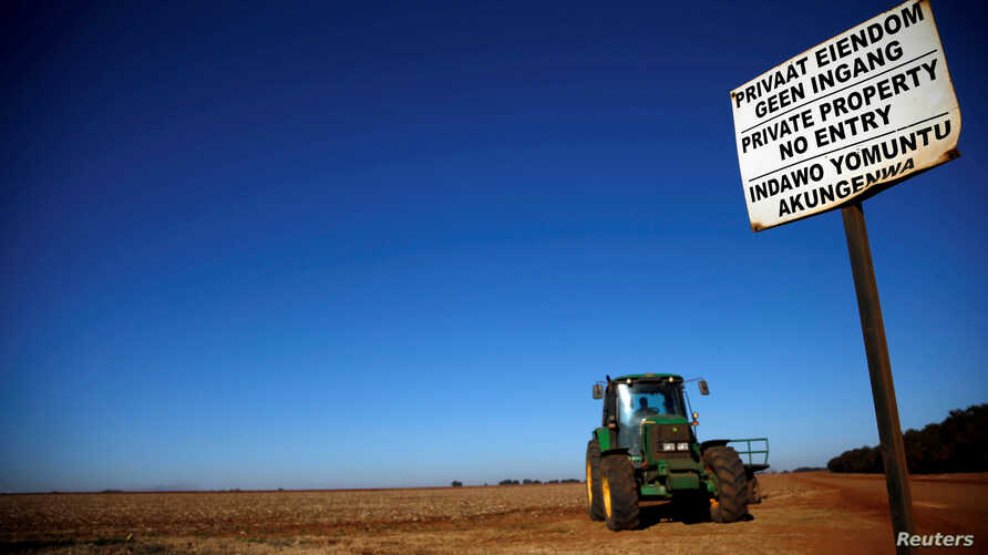 """FILE- A """"no entry"""" sign is seen at an entrance of a farm outside Witbank, Mpumalanga province, South Africa, July 13, 2018."""