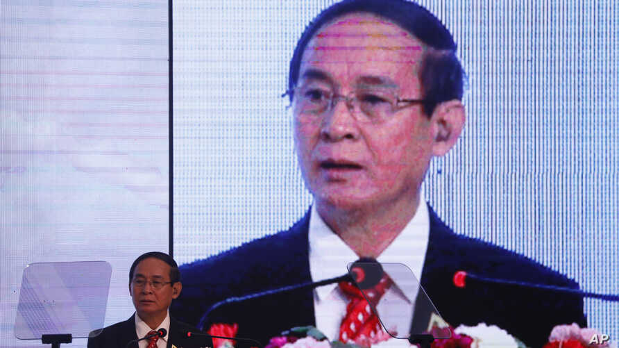 FILE - Myanmar's President Win Myint speaks at a summit in Kathmandu, Nepal, Aug. 30, 2018.
