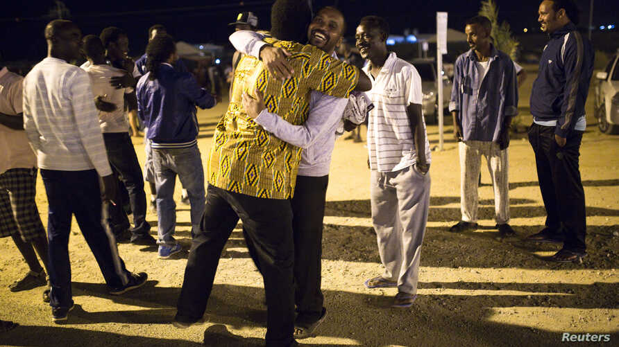 African migrants react after hearing the Israel's high court decision outside Holot open detention center in Israel's southern Negev desert, Sept. 22, 2014.