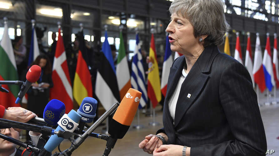 FILE - British Prime Minister Theresa May speaks with the media.