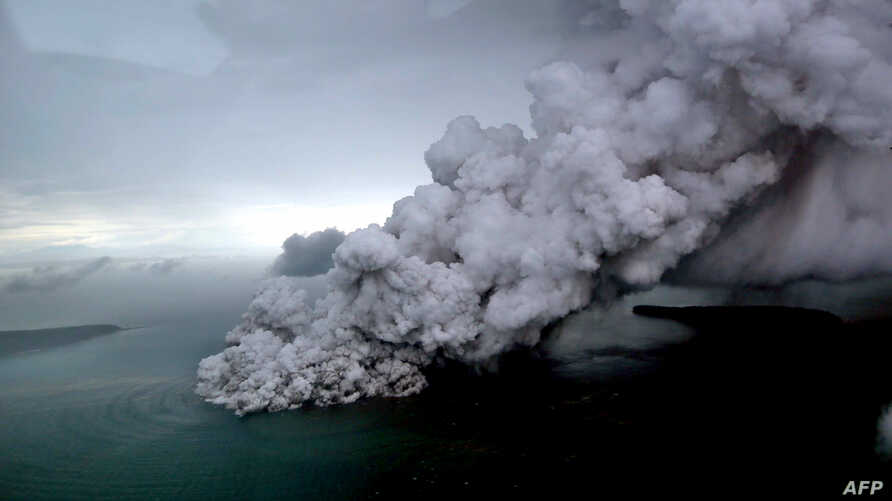 This aerial picture taken on Dec. 23, 2018 by Bisnis Indonesia shows the Anak (Child) Krakatoa volcano erupting in the Sunda Straits off the coast of southern Sumatra and the western tip of Java.