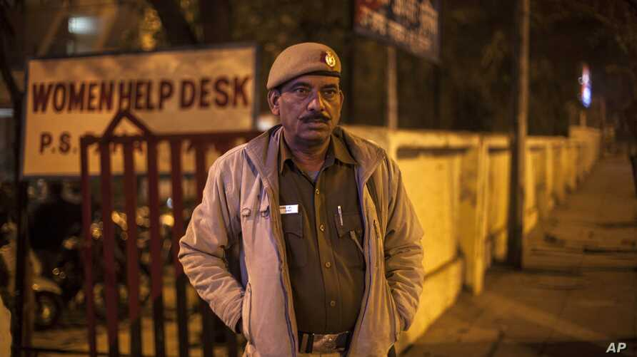 An Indian policeman stands outside the police station which is investigating the gang-rape of a Danish tourist in New Delhi, India, Jan. 15, 2014.