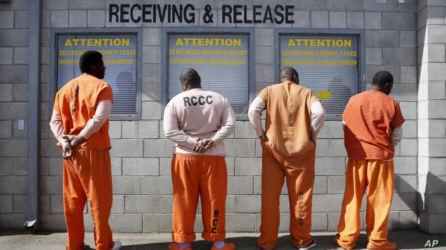 Prisoners from Sacramento County await processing after arriving at the Deuel Vocational Institution in Tracy, California, Feb. 20, 2014. State corrections officials say they are adopting new sentencing rules that aim to trim the state prison populat