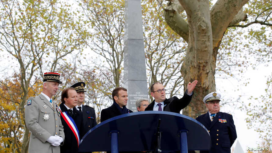 French President Emmanuel Macron attends a ceremony in tribute to French soldiers killed on Aug. 1914 during border battles, in Morhange, Eastern France, Nov. 5, 2018 as part of a World War I commemoration tour.