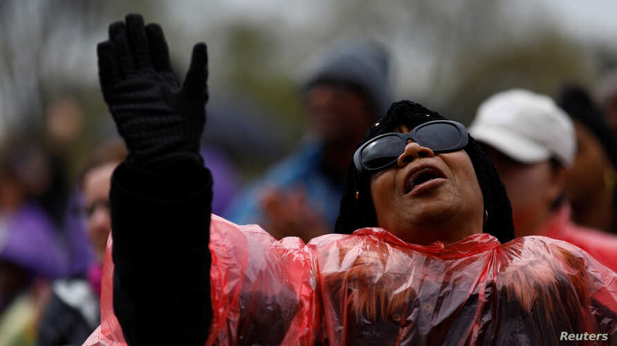 An attendee is seen during a march and rally on the National Mall to mark the 50th anniversary of the assassination of civil rights leader Martin Luther King Jr. in Washington, April 4, 2018.