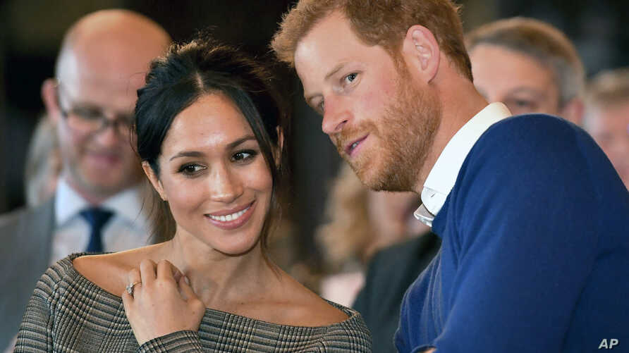 Britain's Prince Harry and Meghan Markle watch a dance performance by Jukebox Collective Cardiff Castle in Cardiff, Wales, Thursday, Jan. 18, 2018.