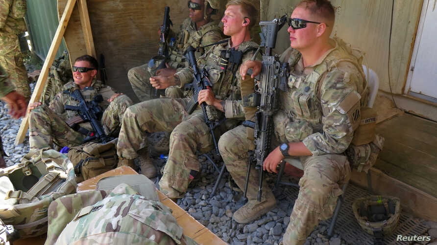 FILE - U.S. military advisers from the 1st Security Force Assistance Brigade sit at an Afghan National Army base in Maidan Wardak province, Afghanistan, Aug. 6, 2018.