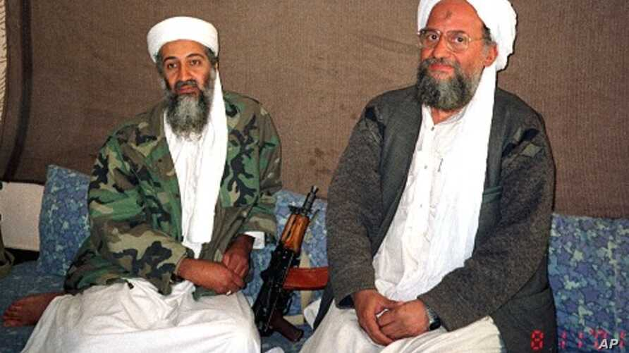 Osama bin Laden (L) sits with al-Qaida's top strategist and second-in-command Ayman al-Zawahri in this 2001 file photo