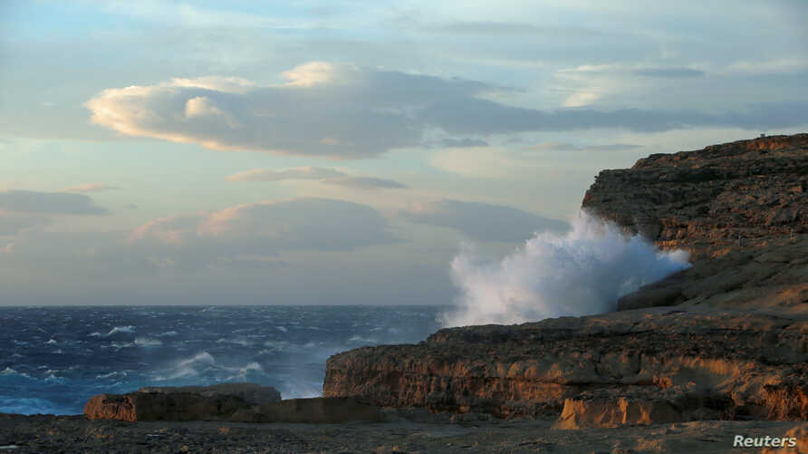 Waves break against the cliffs where the natural structure known as the Azure Window, collapsed after the Maltese islands were hit by rough seas and stormy weather, at Dwejra on the island of Gozo, Malta, March 8, 2017.