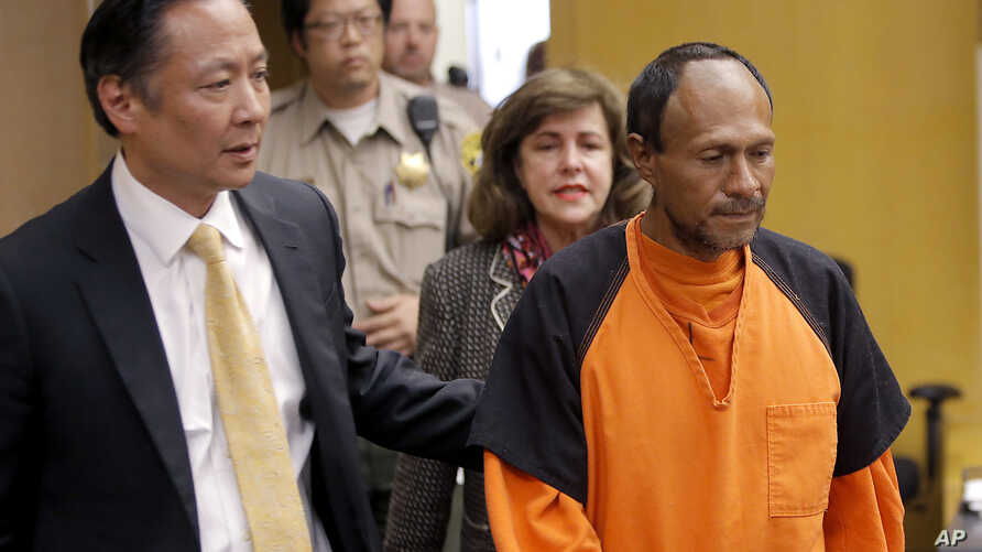 FILE - Juan Francisco Lopez-Sanchez (R), charged with the murder of 32-year-old Kathryn Steinle, is seen being escorted into a courtroom at the Hall of Justice in San Francisco, July 7, 2015.