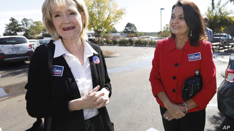 Sen. Cindy Hyde-Smith, R-Miss., campaigns with Teresa Carter, a old friend from Kentucky, Nov. 6, 2018, at Mama Hamil's Restaurant in Madison, Mississippi.