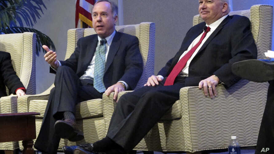 FILE - Wisconsin Assembly Speaker Robin Vos, left, and Senate Majority Leader Scott Fitzgerald speak during a meeting in Madison, Wis., Feb. 7, 2018. In a joint statement, Vos and Fitzgerald defended the Foxconn incentive package they helped create a