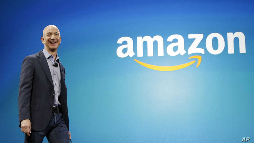 mazon CEO Jeff Bezos walks onstage for the launch of the new Amazon Fire Phone, in Seattle, June 16, 2014.