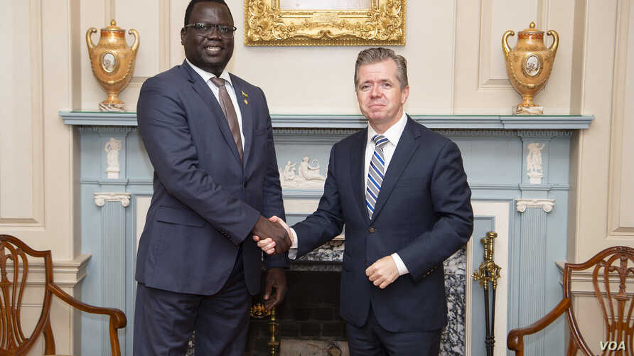 Phillip Jada Natana, South Sudan's new ambassador to the United States meets with the Chief of the Protocol of the United States Ambassador Sean P. Lawler (right) at the State Department in Washington. (State Department photo)