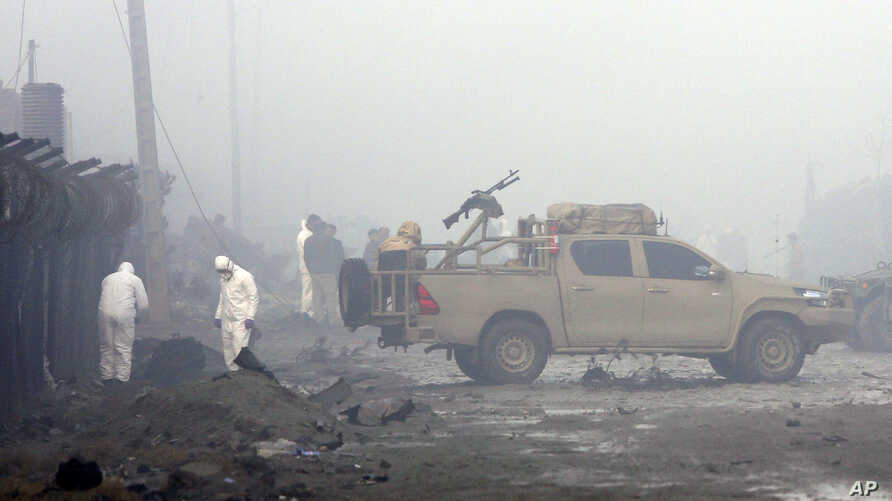 Security forces inspect the site of a suicide bomb attack in Kabul, Afghanistan, Nov. 29, 2018. Taliban insurgents staged a deadly coordinated attack targeting a British security firm in the Afghan capital Wednesday.