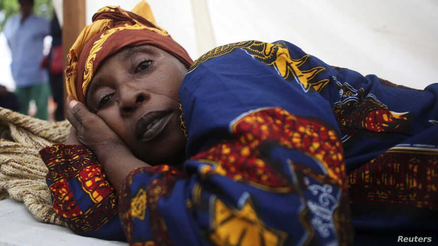 A cholera patient lies in a treatment centre run by Medecins Sans Frontieres on Macauley Street in Sierra Leone's capital Freetown, (File photo).