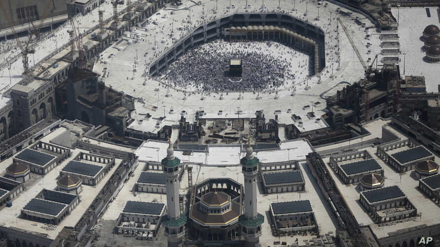 An aerial  of the Grand mosque as Muslim pilgrims walk around the Kaaba, the black cube seen at center inside, during the annual hajj pilgrimage, in the holy city of Mecca, Saudi Arabia, Sept. 2, 2017.