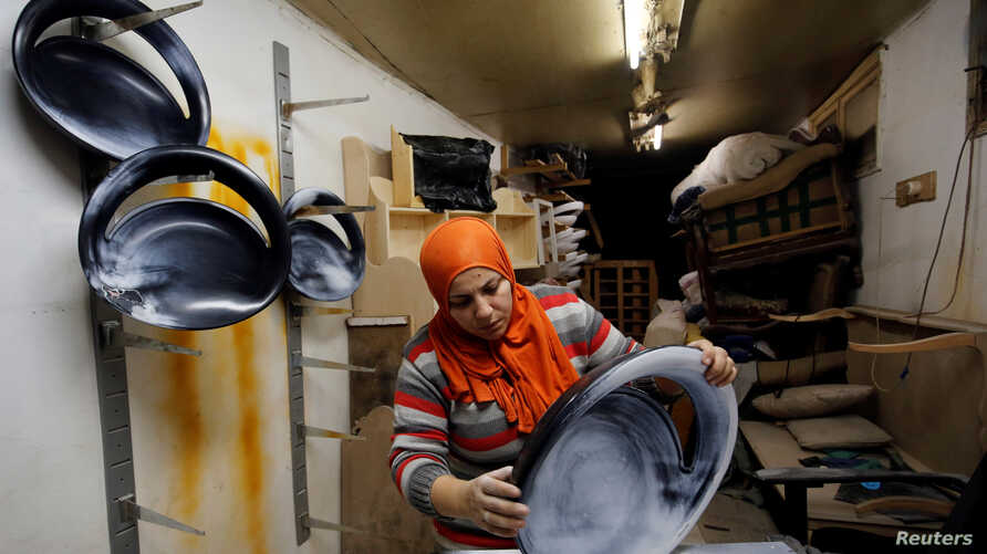 """Carpenter-designer Asmaa Megahed, 30, is pictured in her workshop in Cairo, Feb. 27, 2017. Her message to other women is """"that they shouldn't pay attention to those who comment negatively on the work traditionally for men, forget them. Women can do a"""